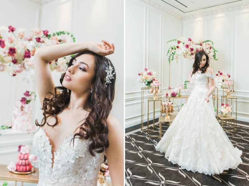 Bride with long brown hair standing in front of wedding dessert table