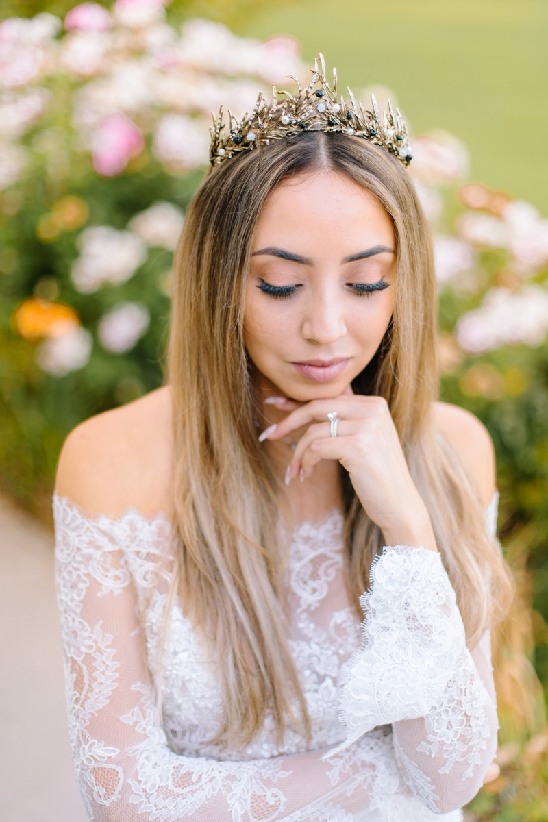 Bride with long parted hairstyle wearing tiara