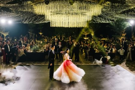 Bride and groom on dance flor under elaborate ceiling display - Picture by Kristian Leven Photography