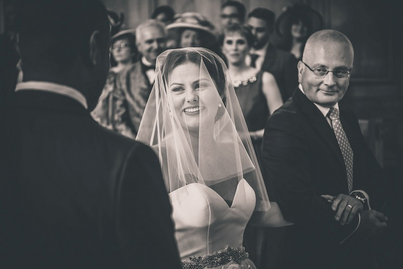 Bride smiling at groom as she gets to the altar - Picture by Mease Valley Photography