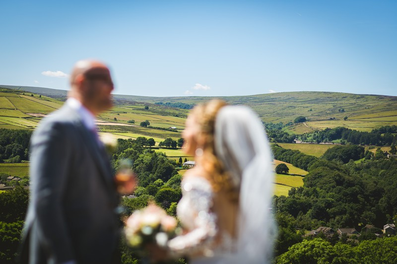 Bride and groom with hills of Holme Valley in background
