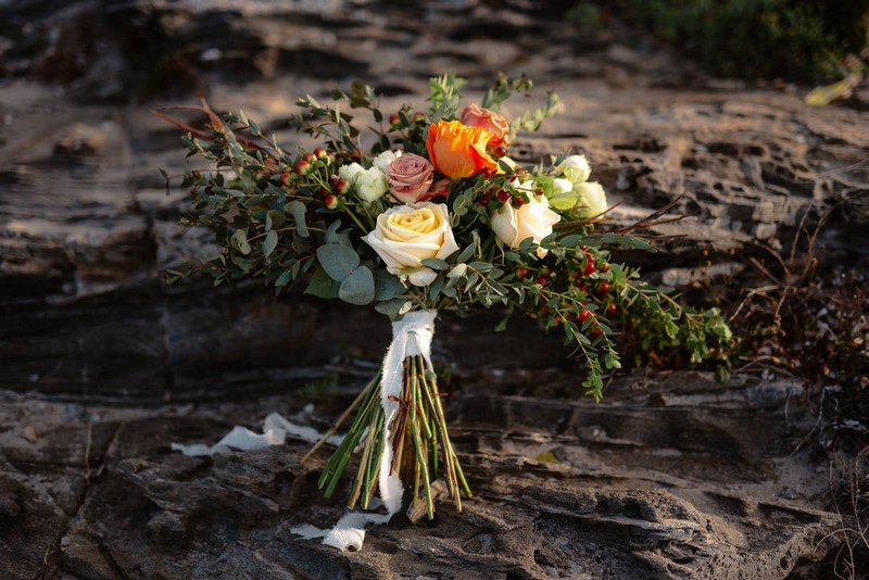 Bridal bouquet with orange, cream and blush flowers