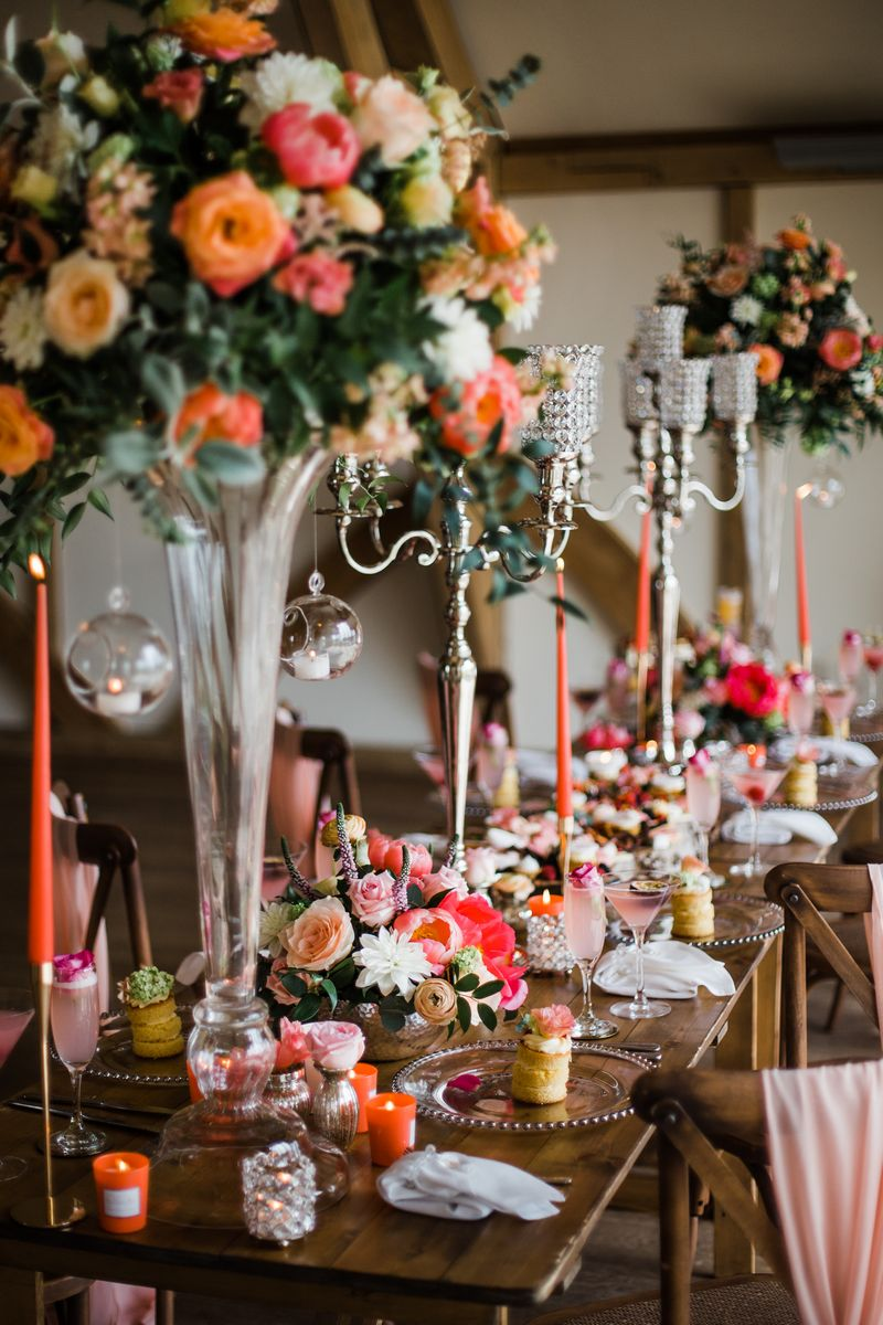 Wedding table with tall flower displays and candelabra