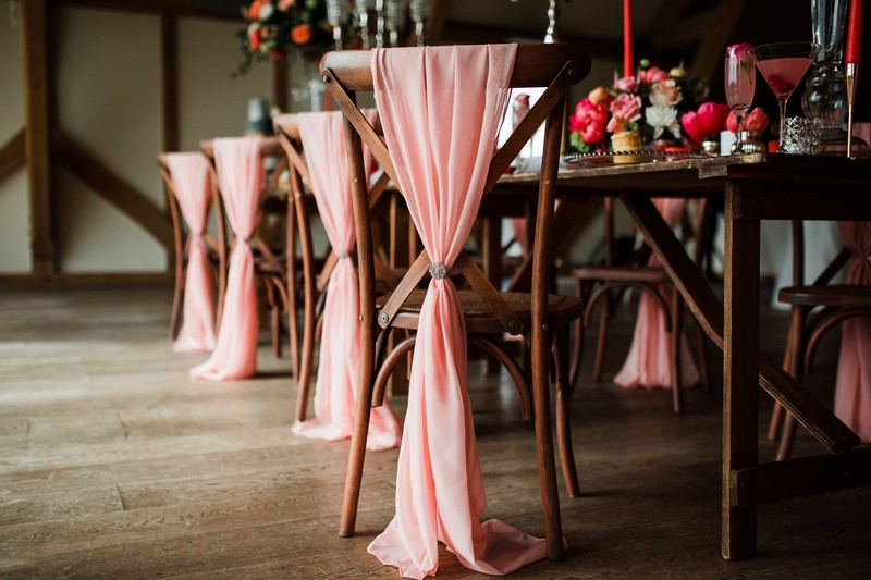 Coral sashes on chairs
