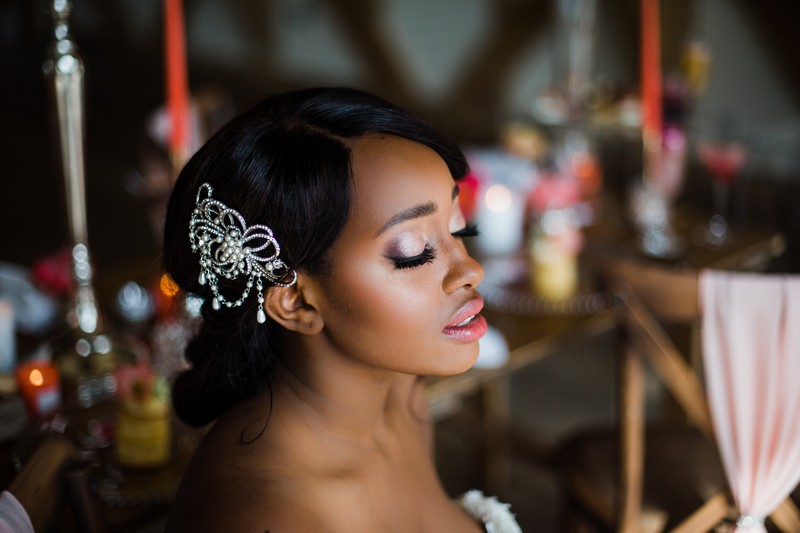 Bride wearing hair accessory with eyes shut