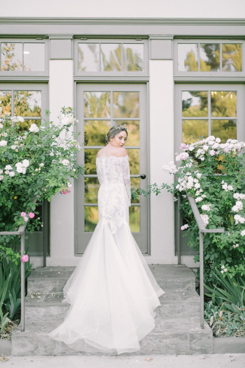 Bride showing back of lace wedding dress