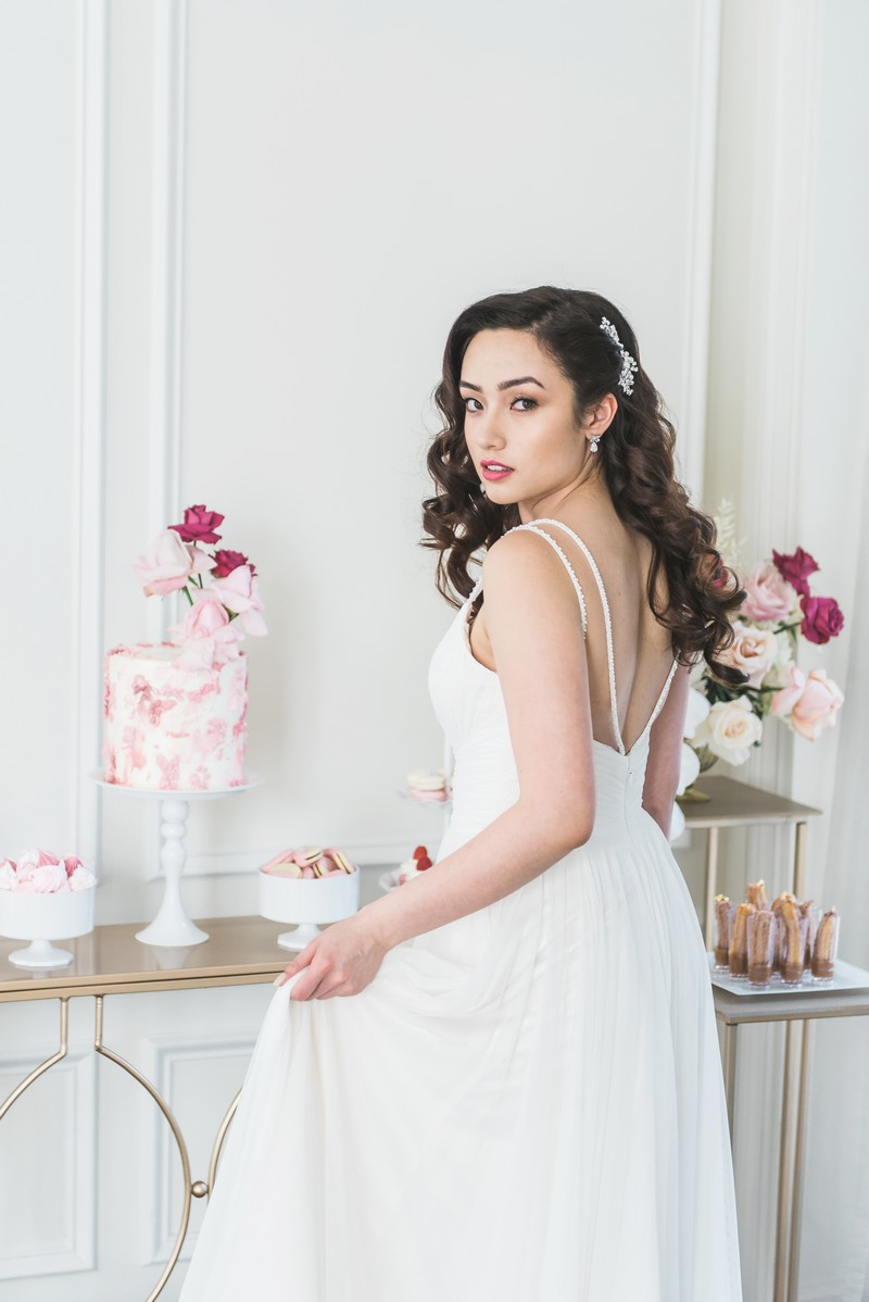 Bride standing in front of dessert table