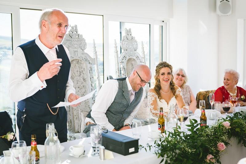 Man giving speech at wedding