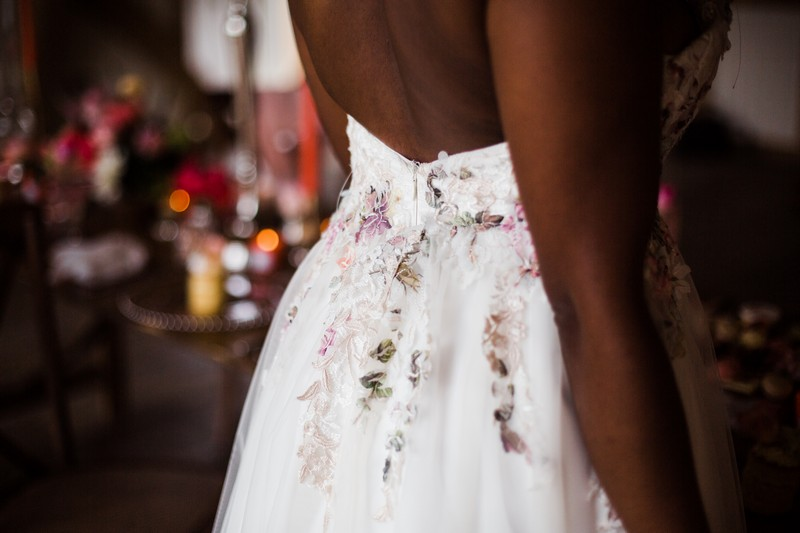 Flower detail on back of bride's dress