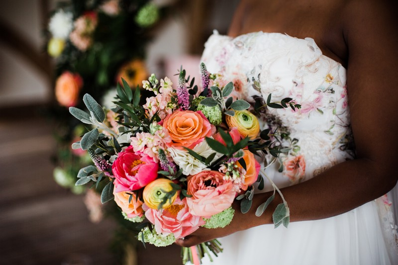 Colourful bridal bouquet with coral and pink flowers