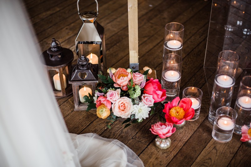 Flowers, candles and lanterns on floor