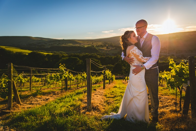 Bride and groom at Holmfirth Vineyard at sun starts to go down