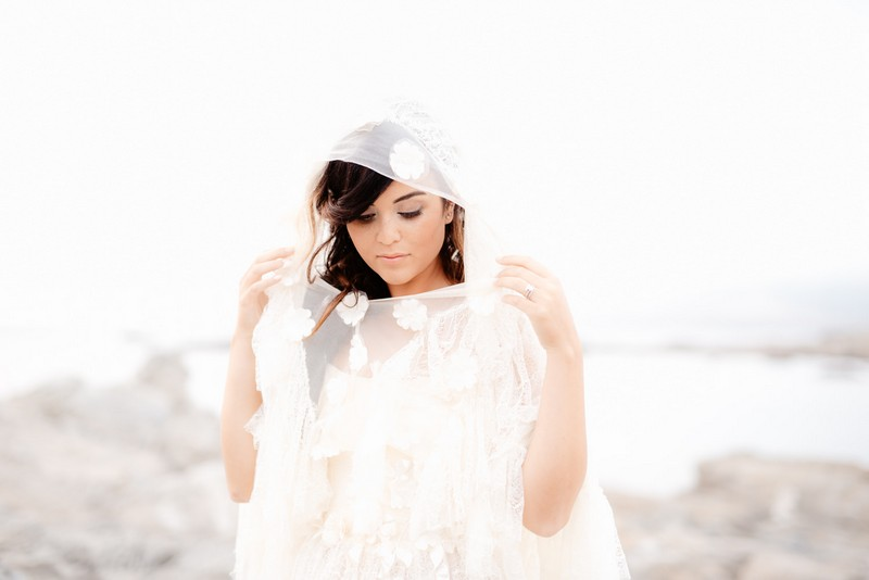 Bride wearing hooded cape