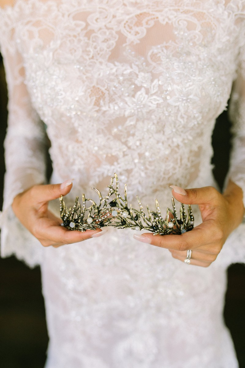 Bride holding tiara in hands