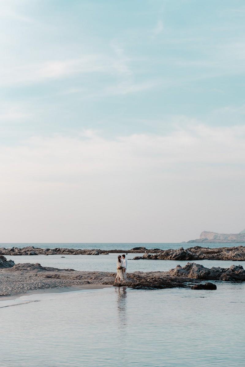 Bride and groom on La Pelosa beach