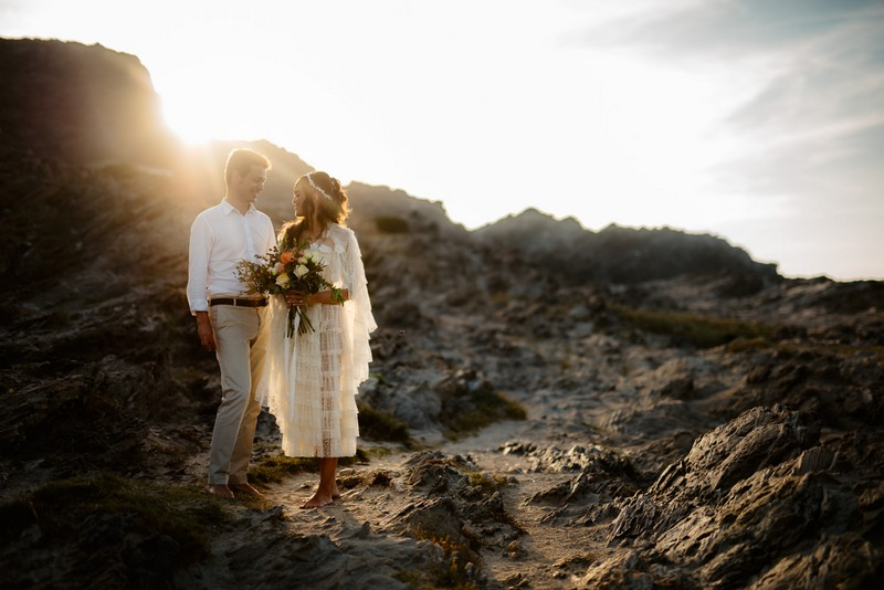 Bride and groom on La Pelosa beach in Sardinia for elopement