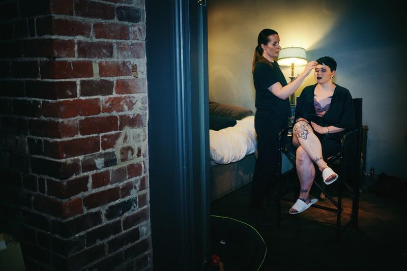 Bride sitting having make-up donw