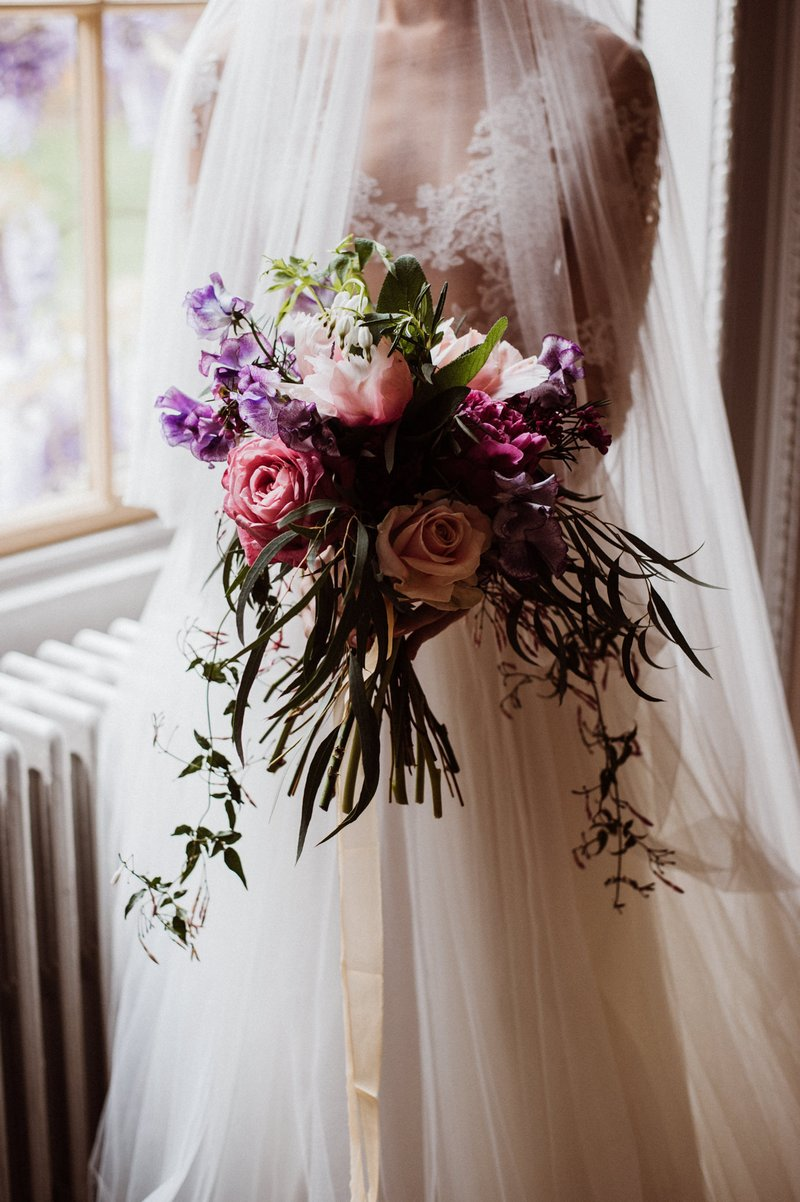 Bride holding colourful bouquet