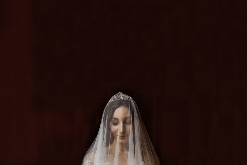 Bride with veil over her face