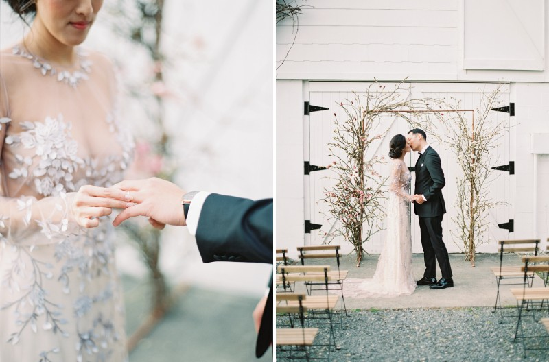 Bride putting ring on grooms finger and kissing groom