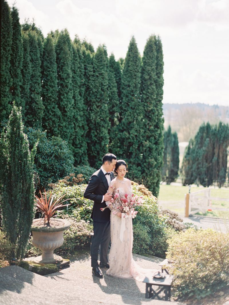 Bride and groom in grounds of DeLille Cellars
