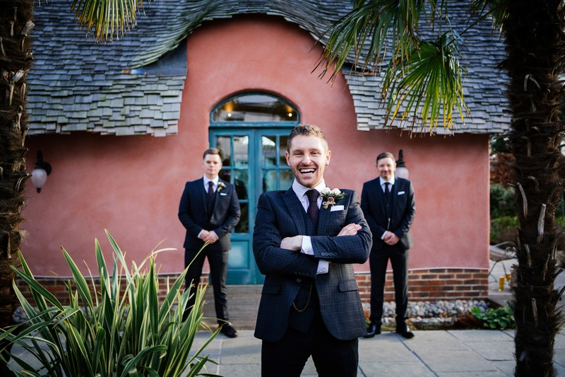 Groom with groomsmen in background