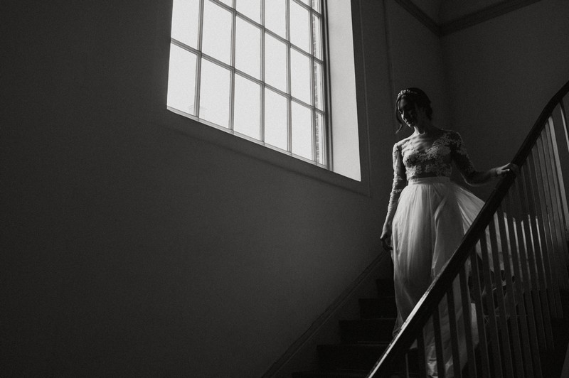 Bride walking down stairs at Fulham Palace