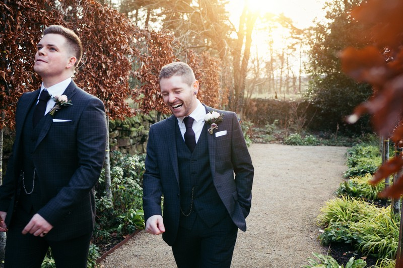 Groom laughing as he walks to wedding