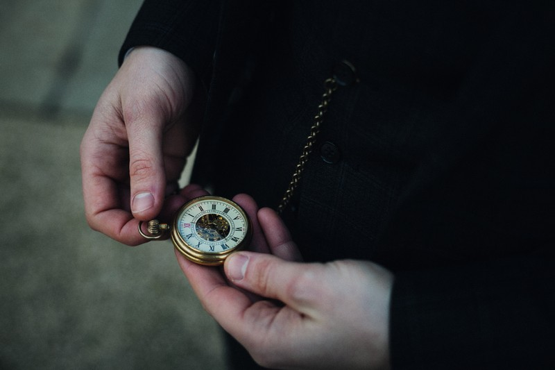Checking time on pocket watch