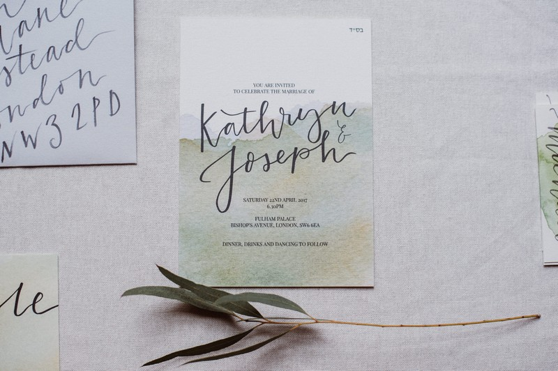 Wedding invitation with green watercolour design