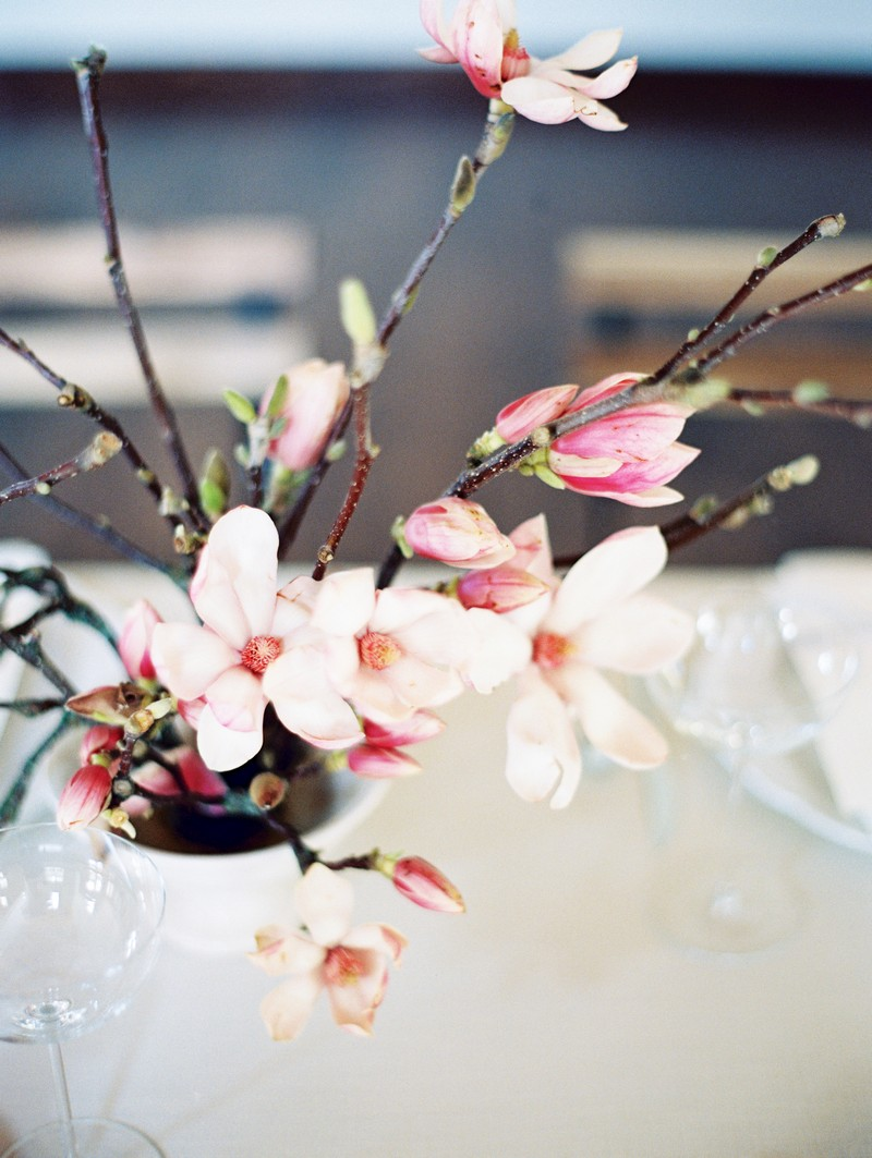 Wedding table display of pink and white magnolia flowers