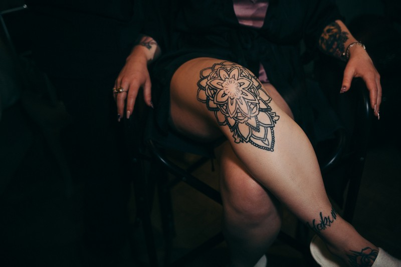Tattoo on bride's leg