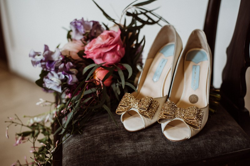 Charlotte Mills bridal shoes on chair next to bouquet