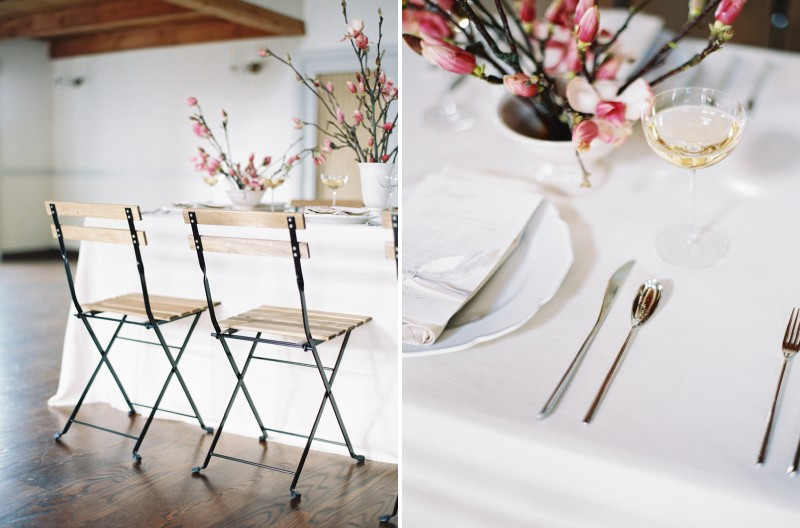 Wood and metal wedding chairs and cutlery at place setting