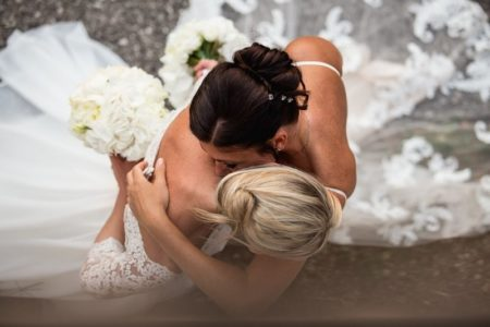 Aerial shot of two brides hugging - Picture by Anna Pierobon Photography