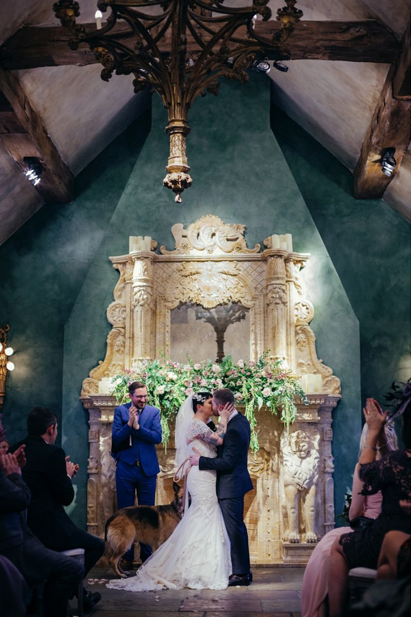 Bride and groom kiss during wedding ceremony at le Petit Chateau