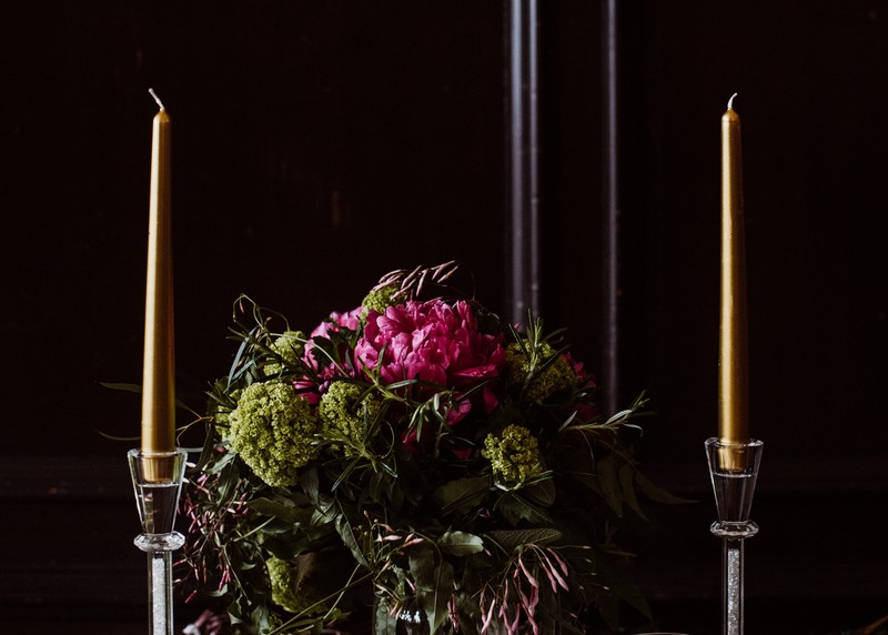 Wedding table flowers and tall candles