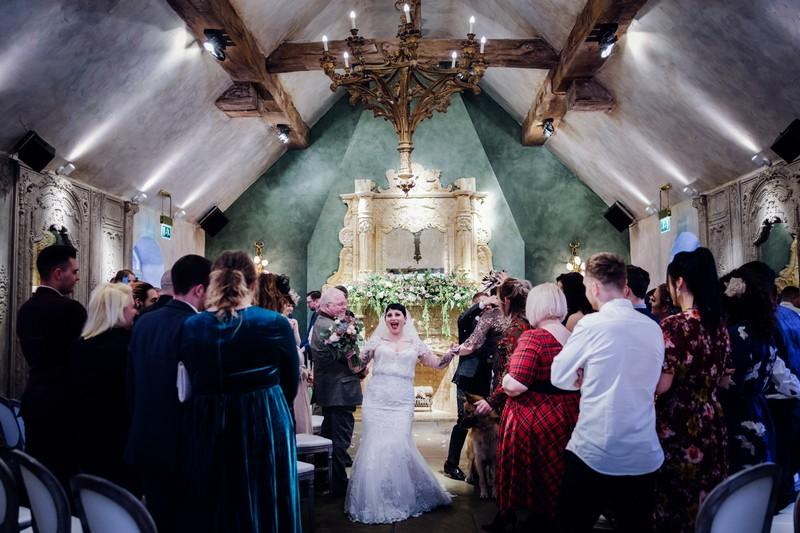 Bride leaving wedding ceremony