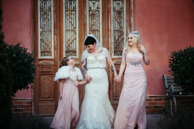 Bride with flower girl and bridesmaid