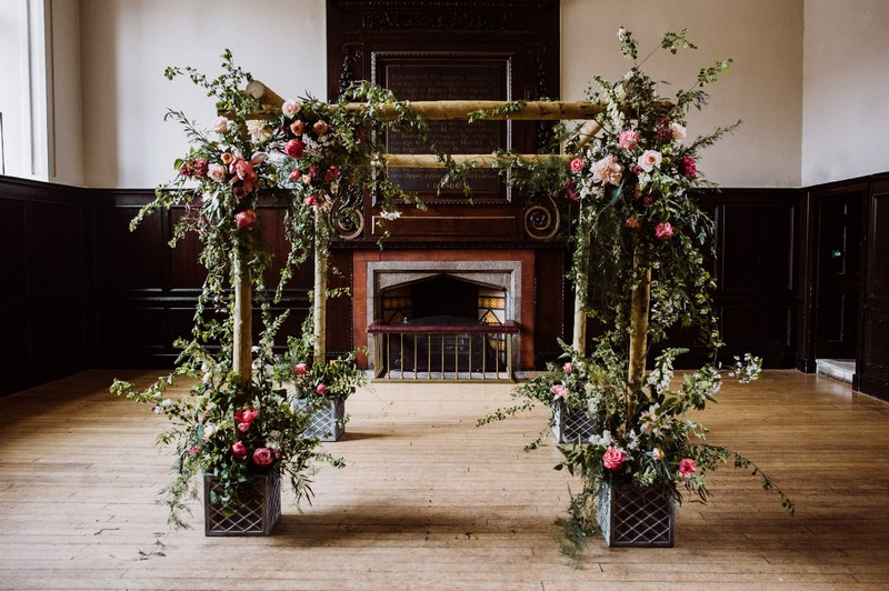 Chuppah styled with flowers and foliage