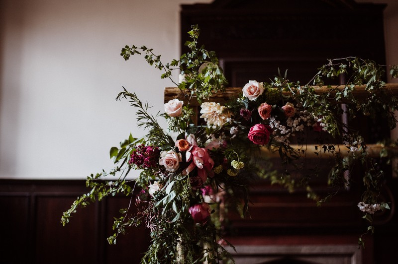Flowers and foliage on frame of chuppah
