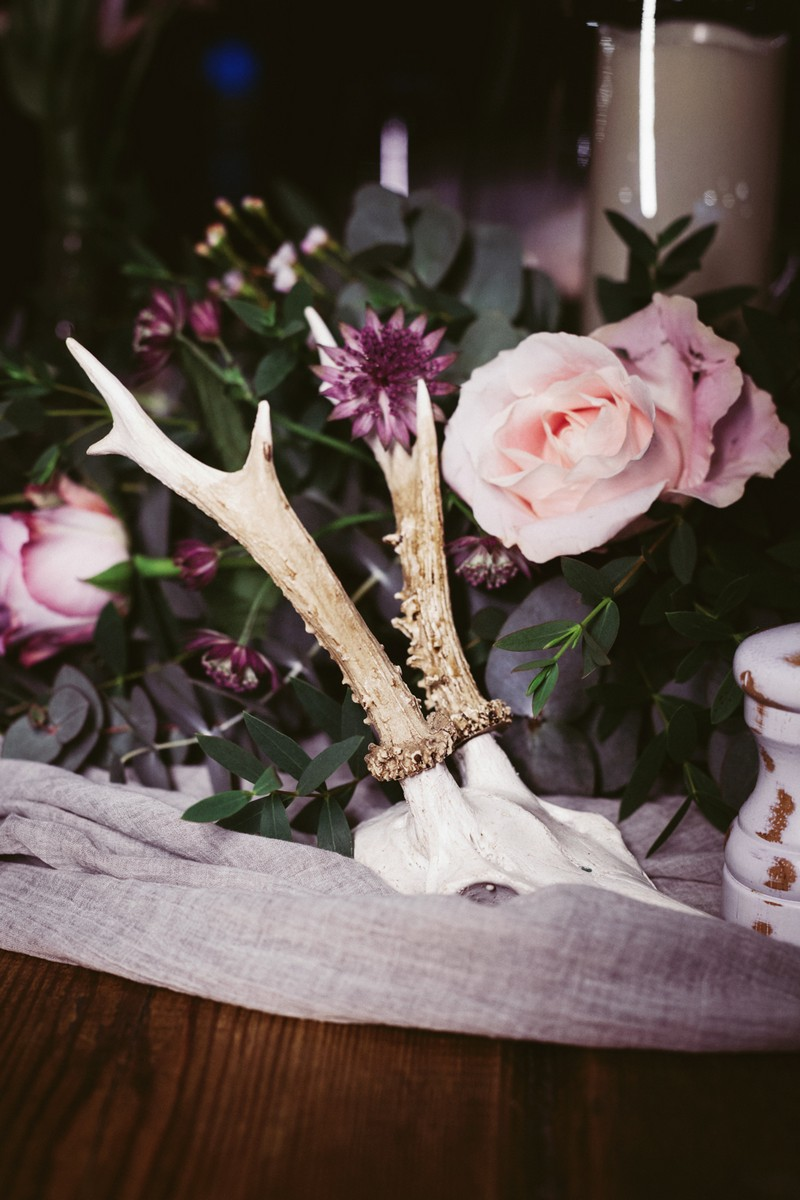 Skull by wedding table flowers