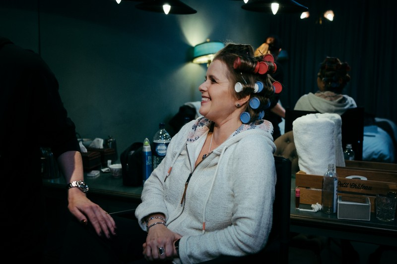 Lady with rollers in her hair