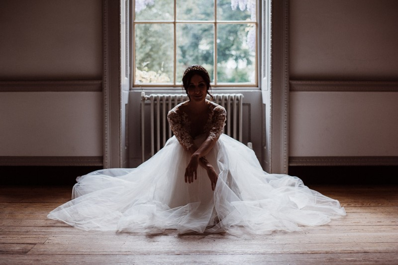 Bride sitting on floor at Fulham Palace
