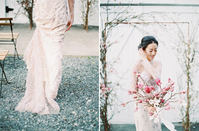 Bride wearing Alexandra Grecco wedding dress in front of magnolia floral ceremony arch