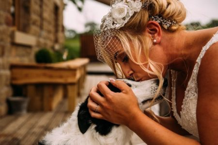Bride kissing dog on the head - Picture by David Scholes Photography