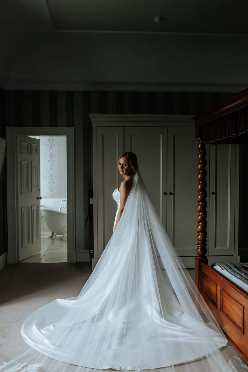 Bride wearing wedding dress with long train and veil - Picture by Rebecca Rose Noller Photography