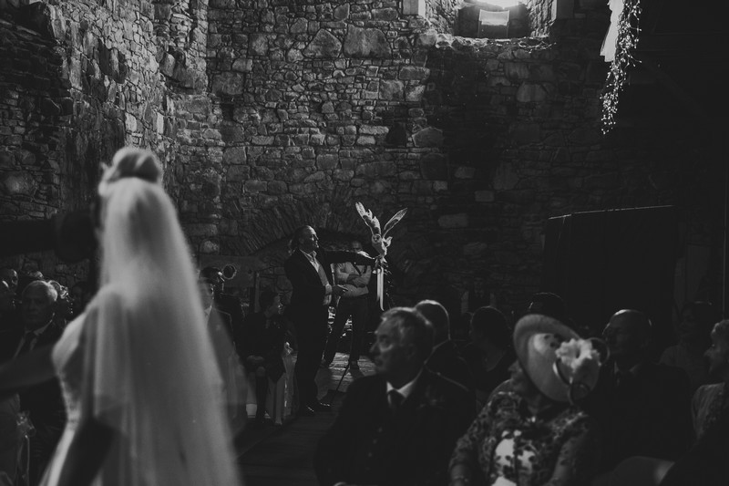 Bride turning in ceremony to see owl deliver wedding rings - Picture by Lorraine Bhandari Photography and Film