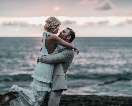 Groom lifting bride up on the beach - Picture by Ben Wigglesworth Photography