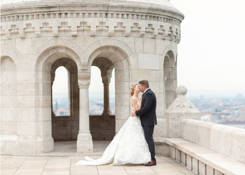 Bride and groom kissing at top of Fisherman's Bastion in Budapest - Picture by Eva Tarnok Photography